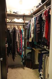 interesting contemporary small walk in closets for kids closet with corner dark wood shelves plus closet railing and clothes hanger under ceiling lighting