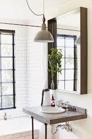 industrial lighting bathroom. an industrial style light fixture in a natural modern bathroom lighting