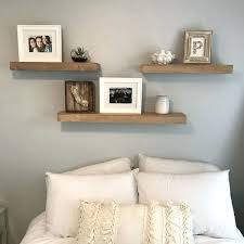 white floating shelves bedroom 3 shelves above bed white and grey bedroom fun room makeover home