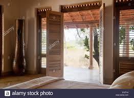 open double doors.  Double Double Doors Open From Bedroom To Veranda Of Goan Beach House Retreat  India  Stock And Open Doors O