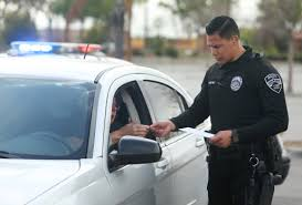 California law says drivers can't use cellphone – other than one tap ...