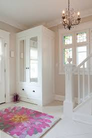 3 5 rugs entry transitional with beige wall chandelier entryway