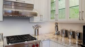 full height wraparound cabinets help this compact kitchen deliver cabinetry countertop cuisine classique