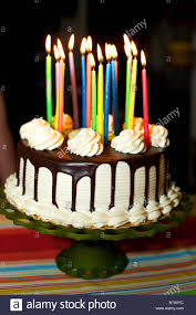 chocolate birthday cake with candles.  Chocolate A Birthday Cake With Lit Candles White Frosting And Chocolate Dripping Down  The Side  Stock Throughout Chocolate Birthday Cake With Candles D