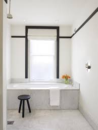 the quintessential built in bath is given a luxe upgrade with a marble surround in