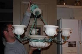 darkening a brass chandelier that has heavy green patina