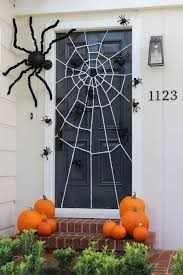 festive Halloween door decoration with a DIY giant spider web and spiders  big and small crawling
