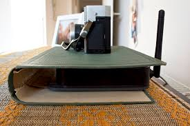 This creative way for how to hide electronics and cords is great for hiding  receivers such as your wireless router or modem. Simply find a large  vintage ...