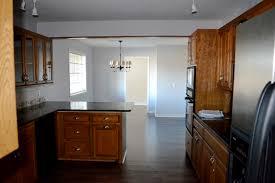 ... Dark Wood Laminate Floor. It Runs Throughout The Kitchen, One ...