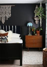 dark bedroom furniture. black walls in a boho bedroom dark furniture
