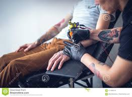 Master Tattoo Artist In Gloves Makes Tattoo Stock Image Image Of