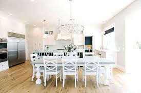 white dining table with gray top and turned legs long big round
