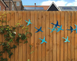 9 Flying birds outdoor wall art made from ceramic that pop out from wall,  birds