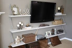 A large shelving unit can provide a great home to the television (via BHG)