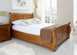 oak finish king size beds for with white rug and grey wall for bedroom decoration