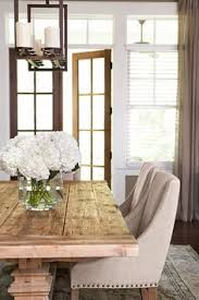dining room decor ideas transitional rustic style in beige and white with farmhouse table upholstered chairetal candelabra light fixture