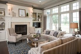 living room with blue area rug with pottery barn fireplace living room traditional with clerestory