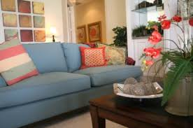 this tetrad room is really modern and interesting the floor blue couch living room ideas