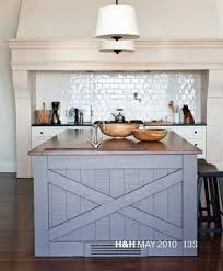 i love this barn door style on the kitchen island