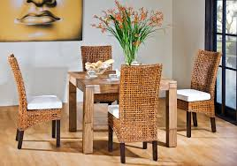 comfy brown wooden sunroom furniture paired. small wooden dining table paired with most comfortable rattan chairs set on laminate floor in comfy brown sunroom furniture
