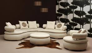 beautiful curved sectional sofa living room furniture round leather ottoman coffee table brown fabric rug brown