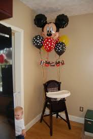 17 best ideas about mickey mouse high chair on mickey next to the decorative table in kitchen with cake have her high chair all decoarate