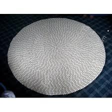 white and off white felt rug