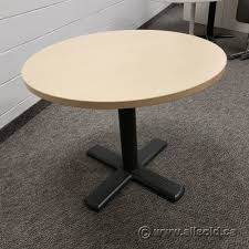 blonde steelcase round table with black base