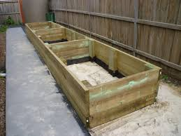 Build Raised Garden Bed Against Fence The Garden Inspirations