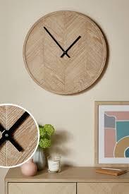 wood effect herringbone wall clock
