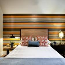Neutral Transitional Bedroom With Striped Accent Wall