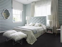 baby blue tufted headboard with white nightstands