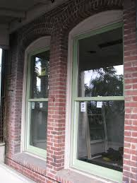 marvin insert double hung in hampton sage on the left existing opening ready for new double hung window on the right