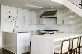 in the kitchen all appliances are tucked inside cabinets to create a more seamless look