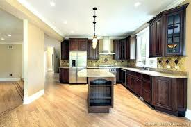 dark cabinets wood floors cherry kitchen with small light