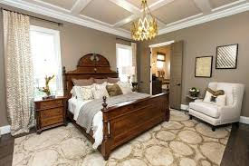 beige bedroom walls dark transitional with wood furniture decorative bedding lighting beige bedroom walls carpet color goes well with gray