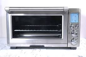 smart oven air sitting on a white painted wooden surface breville countertop convection bed bath beyond