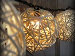 lighting ideas outdoor wicker ball design craft lighting in front of white painted wooden fence