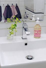 clear glass bathroom accessories. porcelain clear glass bathroom accessories with small plants side sink and large framed mirrors design