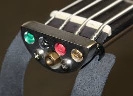 the most obvious thing is keeping it headless similar to ns instruments there are no tuners at the end of the neck instead the ball ends of the strings