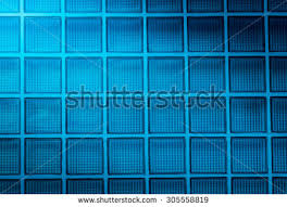 glass block lighting. blue glass block wall background with lighting from corner