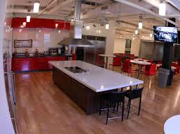 office kitchen. the spacious kitchen sparkles many seamless employees enjoy using it to cook and office