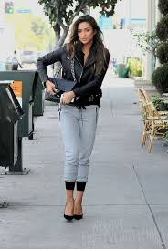 consider pairing a black leather moto jacket with grey jogging pants for an unexpectedly cool ensemble