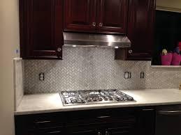 stainless steel backsplash with dark cabinets gas cooktop modern minimalist cream granite backsplash ceramic tile backsplash