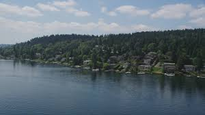Video By The Lake 5k Stock Footage Aerial Video Of Flying By Lakeside Homes With Docks On The Lake Mercer Island Washington