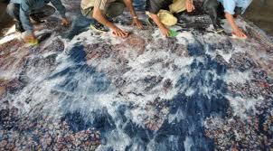 the best method to clean oriental wool or silk area rugs