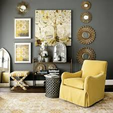 rather dark grey wall and a side table, sunny yellow armchair, artworks and  a