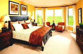 bedroom brightd yellow master bedroom decor ideas with yellow painted wall and curved bay window plus frame wall picture yellow master bedroom decorations