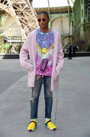 chanel x pharrell adidas. pharrell attends chanel fall/winter 2017 show wearing cardigan, case, cactus plant flea market shirt and adidas hu nmd sneakers x s
