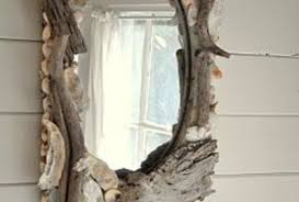 Using shells and driftwood to upgrade a mirror is a great idea.